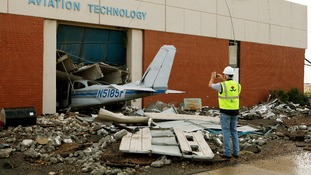Cary Dehart photographs tornado damage at Canadian Valley Technology Center's Aviation Technology building in El Reno, Oklahoma.
