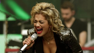 Rita Ora takes to the stage.