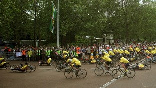 The cyclists ride down The Mall in central London.