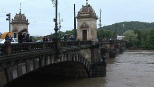 The water in the River Vltava is almost at the level of the city's bridges