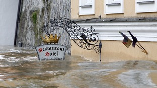 The floodwater has reached the level of this restaurant sign in one part of the town