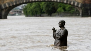 The statue of world harmony leader Sri Chinmoy has become part of the Vltava river in Prague