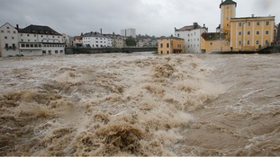 Flooded houses next to river Steyr are pictured during heavy rainfall in the small Austrian city of Steyr