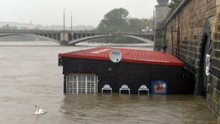 A restaurant at flooded riverside is seen in centre of Prague.