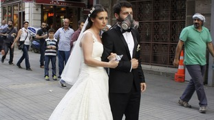 A newly married couple pose for their wedding picture at Istiklal street near Taksim square in Istanbul.