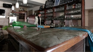 Mud covers the bar of the 'Theatercafe - Aquarium'
