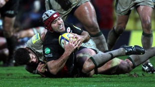 Saracens Schalk Brits is held by Northampton's Phil Dowson