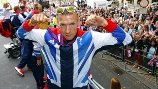 Richard Whitehead takes part in the parade through London, celebrating Britain's Olympic and Paralympic sporting heroes.