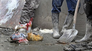 Plastic bags being used to protect feet from the flood waters
