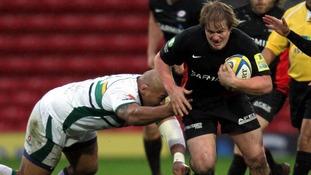 Saracens' Rhys Gill is tackled by Northampton's Soane Tonga'uiha (left)