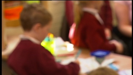 blurred shot of children in classroom