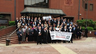 Protesters outside Birmingham Crown Court condemn legal aid cuts.
