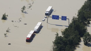 Lorries seen on the flooded motorway A3 near the eastern Bavarian city of Deggendorf