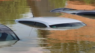 Car roofs stick out of the water in the flooded Deggendorf