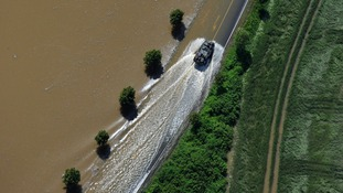 An army truck drives through the water of the Elbe near Strehla, Germany