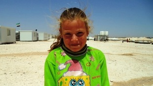 Rawan, 8 , fled from her village in southern Syria after it was shelled by government forces.