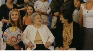 Lydia Spilner celebrates her 100th birthday with family.