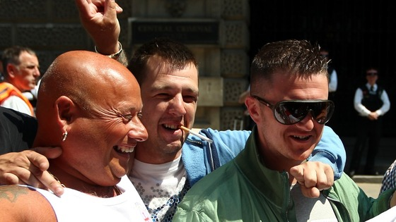 EDL leader Tommy Robinson with supporters outside the Old Bailey today.
