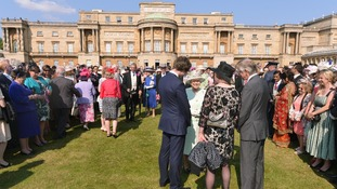 Queen Elizabeth II meets guests at a Garden Party at Buckingham Palace