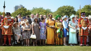 Guests wait for Queen Elizabeth II at a Garden Party at Buckingham Palace, London