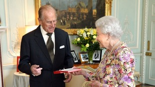 The Duke of Edinburgh smiled as he received the the Order of New Zealand from the Queen yesterday.