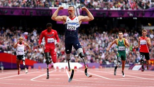 Richard Whitehead celebrates victory in the 200m sprint