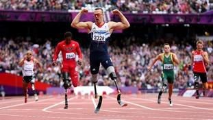 Richard Whitehead celebrates victory in the 200m sprint