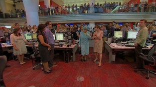 The Queen was taken on a tour of the revamped newsroom in central London.