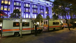 Police vans at the scene of a smash and grab robbery in Selfridges last night