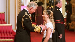 Cyclist Laura Trott receives her OBE medal from the Prince of Wales