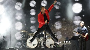 Robbie Williams performs during the Capital FM's Summertime Ball at Wembley Stadium in London.
