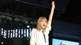 Taylor Swift delights the crowd with her performance.