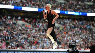 Jessie J dances on the stage at Wembley.