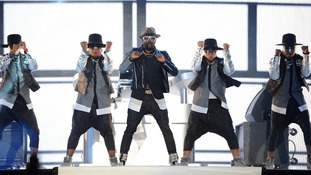Will.i.am and his backing dancers perform in London.