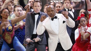 Host Neil Patrick Harris performs with boxer Mike Tyson.