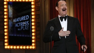 Actor Tom Hanks reacts before presenting an award at the Tonys.