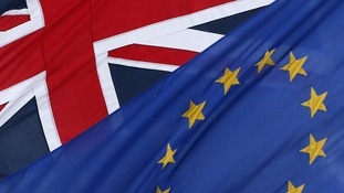 British and EU flags.