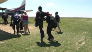 An injured solder hops towards the plane