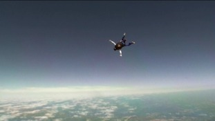 Another soldier takes part in the sky dive above Salisbury Plain.