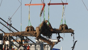 Lifting equipment raises a World War II Dornier bomber