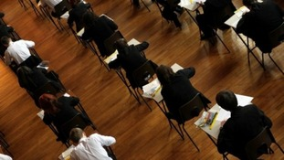 Pupils sit a GCSE maths exam