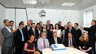 Staff celebrate the Cambridge & Counties Bank's first anniversary