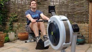 Scott Etherington trains on a rowing machine