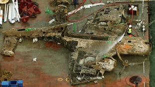 The remains of a crashed Dornier bomber on a barge near Deal.