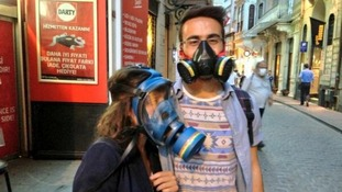 A couple wear gas masks in the Beyoglu district of Istanbul