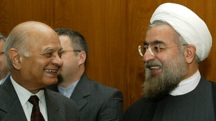 Hassan Rouhani (R) in a former guise as Iran's chief nuclear negotiator with India's national security advisor Brajesh Mishra