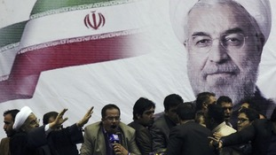 Iranian presidential candidate Hassan Rouhani (L) waves to supporters in the central Iranian city of Shiraz