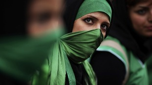 Supporters of presidential candidate Mir Hossein Mousavi wear green colours at a rally in Tehran in 2009