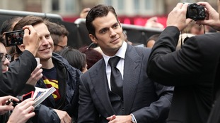 British actor Henry Cavill poses with fans in Leicester Square, London