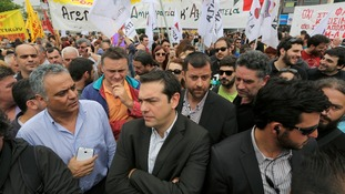 Greek leftist opposition leader Alexis Tsipras takes part in a rally outside the Greek State broadcaster ERT headquarters
